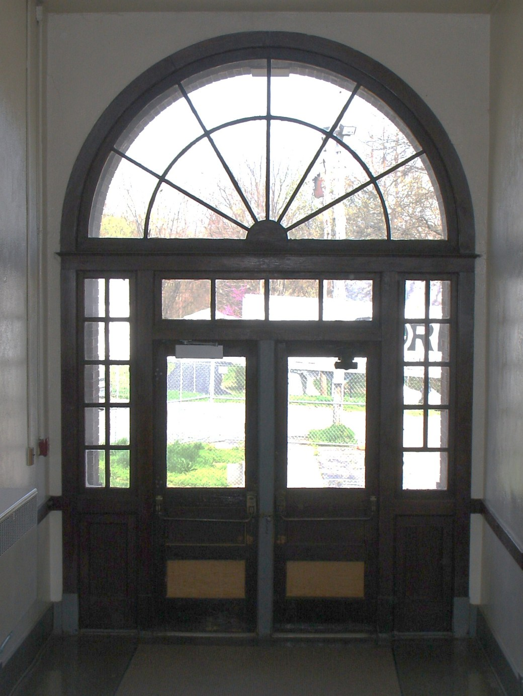 from inside - east door of 1920 school facing n. walnut - housed all 11 grades (only 3 yrs of hs offered)